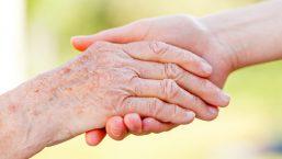 elderly hand shaking