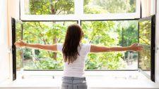 woman opening her kitchen windows