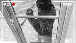 burglar man prying a window open