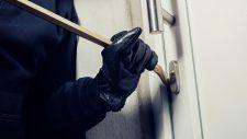 burglar prying open a door